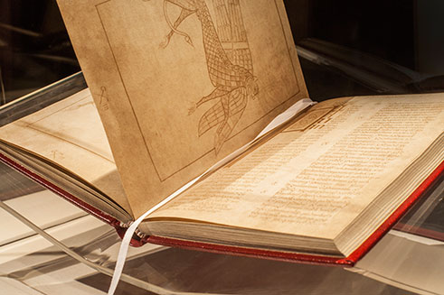 A beautifully lit image of the Book of Armagh, in St Patrick's Trian Centre, Northern Ireland.