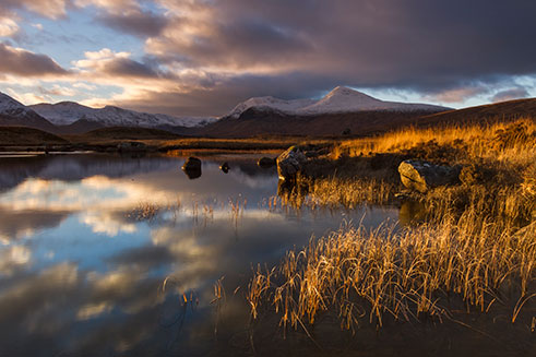 A beautiful photographic image of sunset over Rannoch Moor, in the Scottish Highlands, in winter.